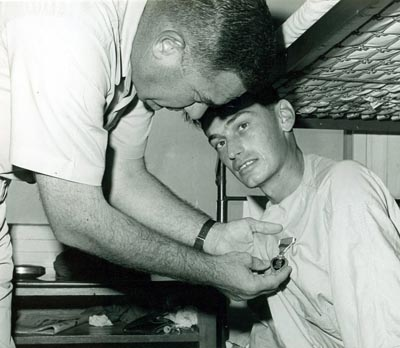 SSgt Habecker, Barry L., AF13546189, wounded in action on 4 Dec 1966, is presented the Purple Heart at U. S. Army 3rd Field Hospital by Col Grover K. Coe, Tan Son Nhut's Base Commander.