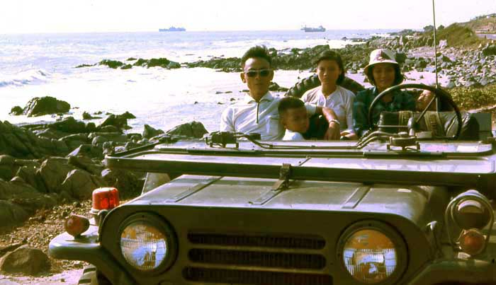 ARVN Sgt Duc, wife, and daughter, in jeep at beach with MSgt Summerfield-1969: 10