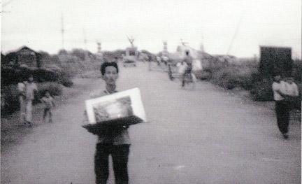 Downtown Bien Hoa, with ever present Arts Dealer.