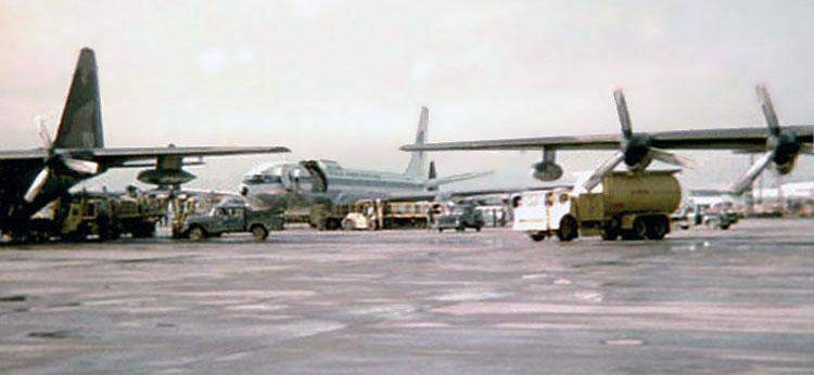Bien Hoa AB, flight line. C-130s and Freedom Bird. 1969-1970.