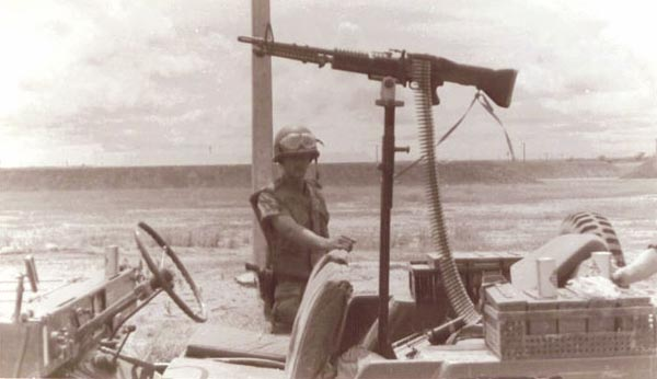 10. Bien Hoa AB. SP QRT jeep, Airman John Beam with M60. Photo by: Vinson (?).