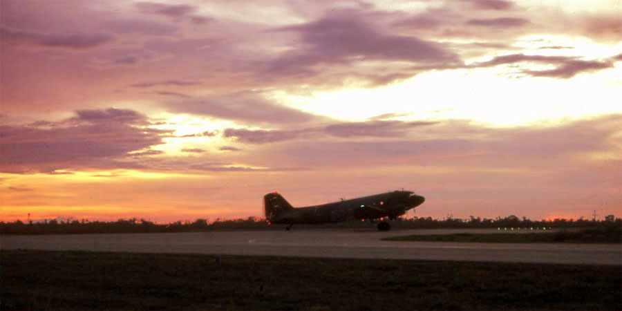 Bien Thuy Air Base, flight line and runway at sunset. C-47 taxies for takeoff. MSgt Summerfield: 01