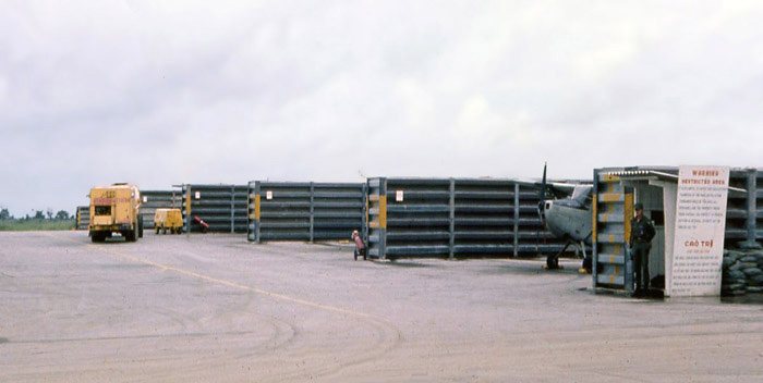 Bien Thuy Air Base flight line. USAF SP guards entrance to O1E-Birddog revetments. MSgt Summerfield: 14