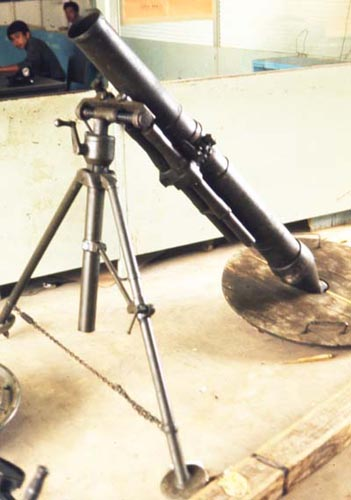 Bien Thuy Air Base, Captured VC weapons and mortars. MSgt Summerfield, 1968: 06