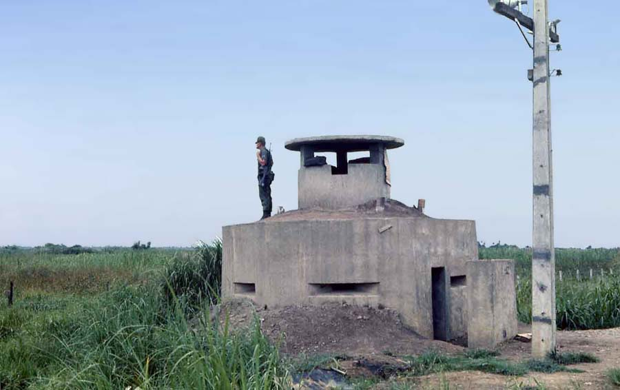 Bien Thuy Air Base, Good Morning World. SPS Airman stands watch from perimeter-bunker with 50cal inside. MSgt Summerfield: 05