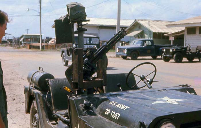 Bien Thuy Air Base, USAF SPS jeep, and US Army jeep with mini-gun. MSgt Summerfield, 1968: 19