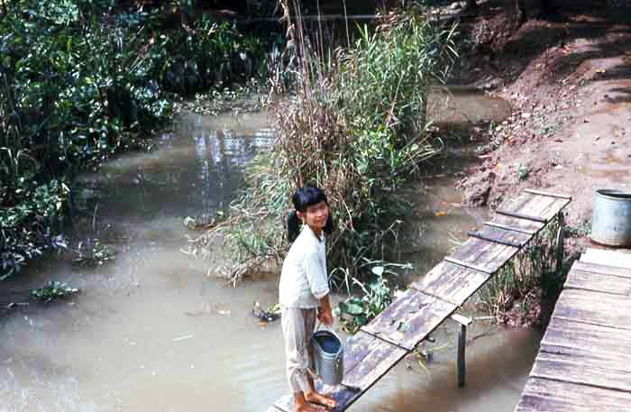 Bien Thuy Air Base. Village girl fetching river water. MSgt Summerfield: 08