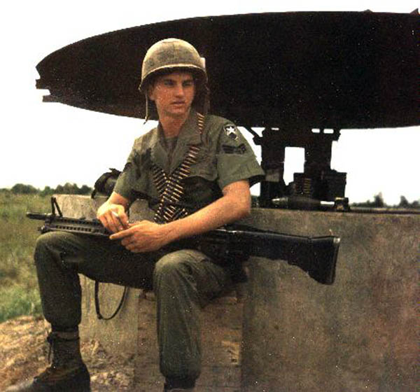 12) Mike Mckeal, Bunker duty with M60 and ammo belts.