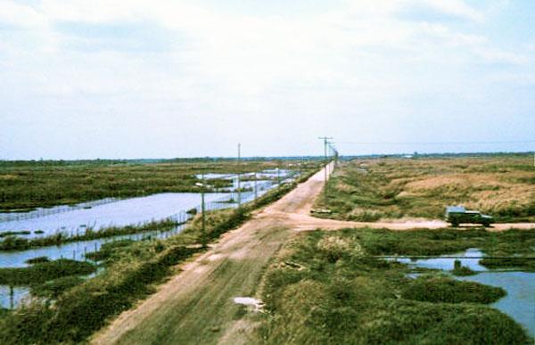 028: Binh Thuy AB, perimeter road. Photo by: Dr. Mel Hecker, 1968