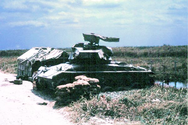 032: Binh Thuy AB, perimeter with tank. Photo by: Dr. Mel Hecker, 1968