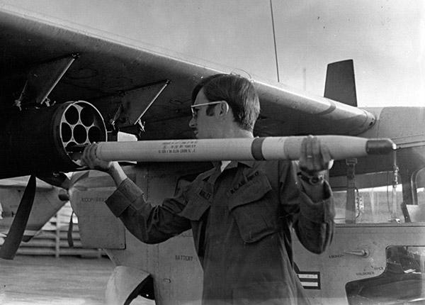 9. Binh Thuy AB, flight line: Dan Manley, loading-rockets.1970-1971.