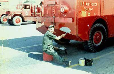2. Me patching up shrapnel holes from a mortar attack 1969.