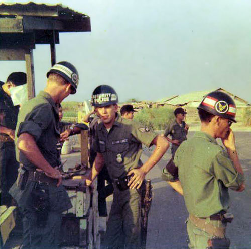 13. A1/C Byrd, SGT. McFarland & QC guard at the main gate to Binh-Thuy AB 1968.