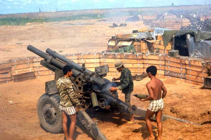 ARVN 105mm Howitzer crew, firing H&I. MSgt Summerfield, 1968: 30
