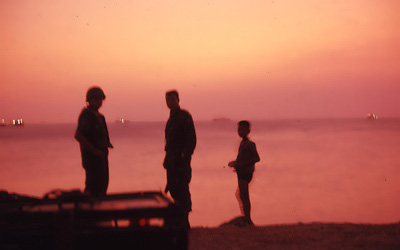 Bien Thuy, sunset at South China Sea. Freighter ships on horizon. MSgt Summerfield: 20