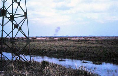 2. Binh Thuy AB: Perimeter Tower. Possible shell burst on center-horizon. 1968. Photo by: Mel Hecker, LM 72, DN, 366th SPS; DET CB; DH, 1/620th TCS; BT, 632nd SPS. 1967-1969.