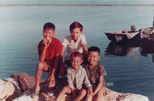 12th SPS Neptune Boat Dock. Myca boys setting on rock, 1969-1970