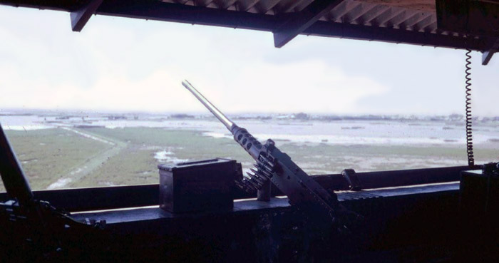 10. Cam Ranh Bay AB. Perimeter Tower view. M-16 (lower-left) and .50-Cal on the counter. 1970. Photo by: Jim Randall, LM 69, CRB, 483rd SPS, 1970.