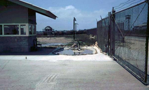 1a. Cam Ranh Bay AB, Gate. Note the Tower through the sliding-gate. See anything unusual? Photo by: unknown.
