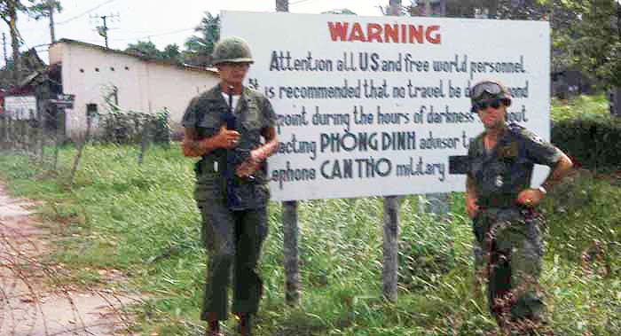 Can Tho area. Sign Reads: WARNING Attention all US and free world personnel. It is recommended that no travel be conducted from this point during the hours of darkness without contacting PHONG DINH advisor team. Telephone CAN THO military police. MSgt Summerfield: 10
