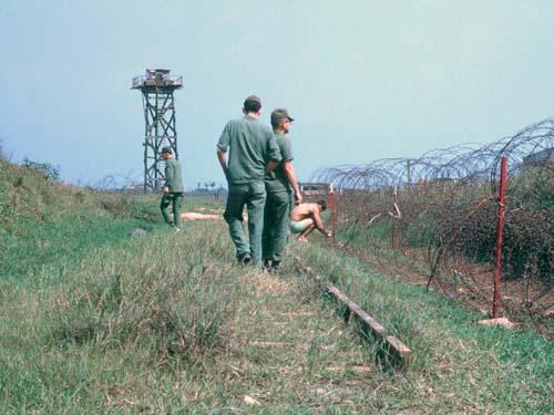 3. Đông Hà Air Field: Perimeter Tower, and setting mines. Photo by: Dr. Mel Hecker, LM 72, DN, 366th SPS; DET CB; DH, 1/620th TCS; BT, 632nd SPS. 1967-1969.