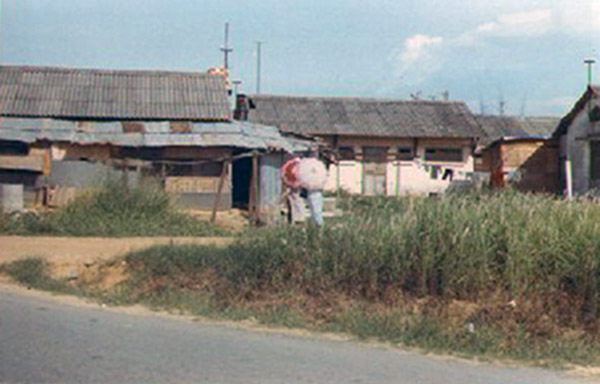 12. Da Nang AB: ARVN Vietnamese housing across from SPS hooches. Photo by Alan Ellison, 1968.
