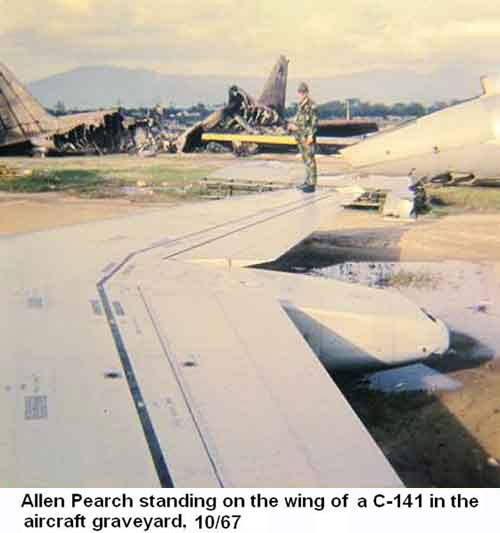 Da Nang Air Base, SVN: USAF Allen Pearch standing on the wing of a C-141 Starlifter in the aircraft graveyard. Oct. 1967.