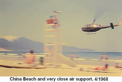 Da Nang Air Base, SVN: USAF, Knelly at China Beach with Monkey Moutain in photo background. Photo: Note low flying Huey checking out the Vietnamese girls on the beach. Apr. 1968. © 2011 by Bradford K. Deal