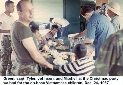 Da Nang Air Base, SVN: USAF Green, SSgt Tyler Johnson, and Mitchell at Christmas Party for Vietnamese kids. Dec. 24, 1967.