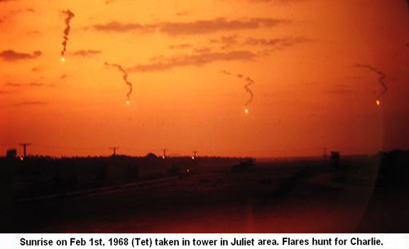 Da Nang Air Base, SVN: USAF. Sunrise Feb. 1, 1968 TET, photo view from 366th SPS tower in Juliet Area. Flares hunt for Charlie. © 2011 by Bradford K. Deal.