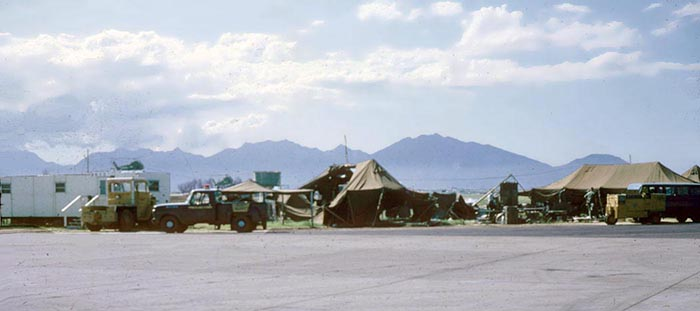 4. Maintenance troops flight line tents.One was pretty pretty much destroyed.Fortunarely, they all escaped out the back and went to the bunker.If they had gone out the front, they would have triggered a trip grenade. Debis in the middle of the 509th FIS detachment Maintenance trailers and tents area.