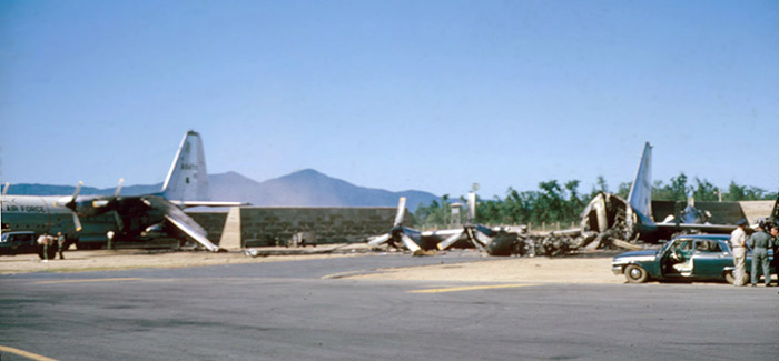 7.This photo Is a long shot of the aircraft after the attack, what's left of the C-130which was loaded withflares,and a C-124 (?)also damaged in the raid.