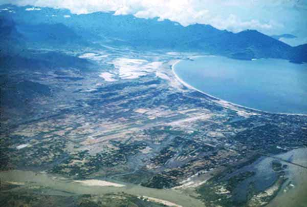10. An airborne photo of Da Nang AB. The runway runs from the SW to the NE. This spectacular photo shows Da Nang AB (center), Freedom Hill 327 (center left), China Beach (center right), and Monkey Mountain along the bay's coastline just out of view (top right).