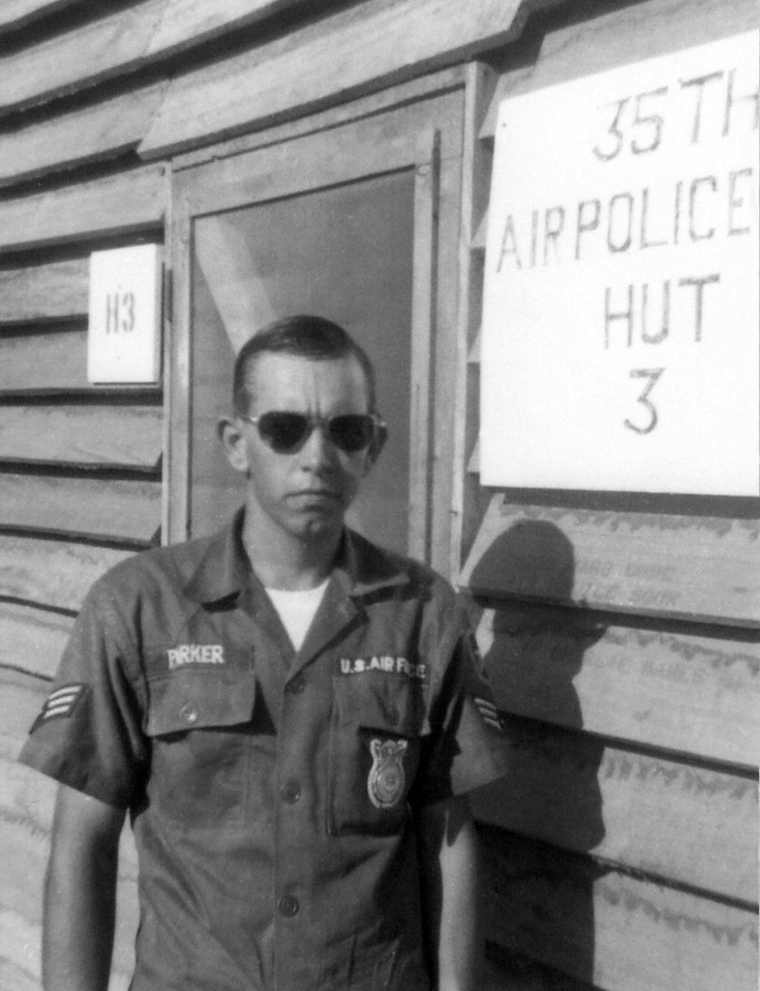 12. A1C Darrell Parker, front of new 35th APS Hut #3.