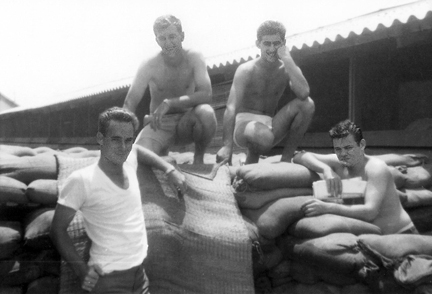 15. Da Nang AB: Off duty 35th APS airmen hang around sandbag bunker they might take shelter in during a mortar attack. Photo: Left/front: Charles Mcilwain; Right/Front: James McNall; Top/left: Charles Schidknecht (deceased); Top/right: Joe Campo.