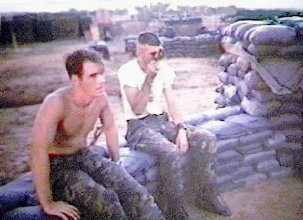 [6] Sgt Doug Lilly and Russ Harrell laying in the baseplate and the aiming-stakes at the 81mm Mortar Pit Da Nang AB, RVN 1969.