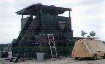 [9] Bunker and tower at the mortar site, south end of Da Nang AB, RVN 1969. Bunker and Tower were used for living quarters for the Mortar Crew,