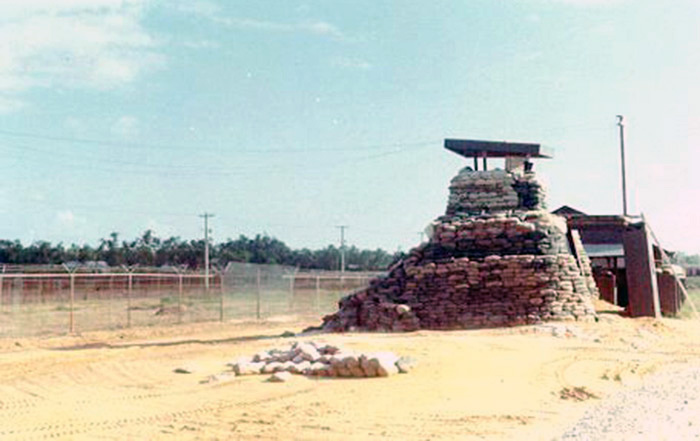 1. Da Nang AB: SP Tower-Bunker post on the Perimeter, by Camp Da Nang, which later became known as Gunfighter Village. Spooky used to have nightly workouts in the treeline in the background of this picture. Photo by Vernon Hodge, 1968.