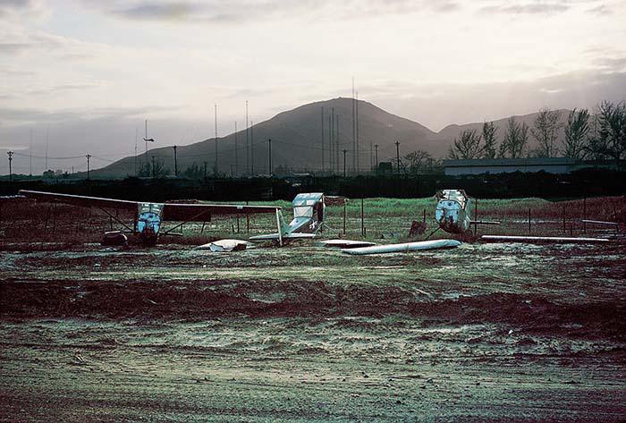 1965 Da Nang AB, South Vietnam: O-1E Birddog aircraft boneyard.  View outside the read of my tent.  Don Poss