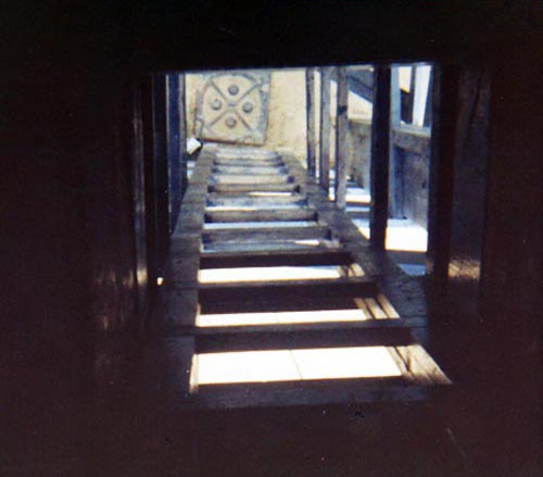 5. Da Nang AB, Perimeter Tower. View from top of tower, looking down the ladder toward the ground. Photo by: Konrad Kottke. 1971-1972.
