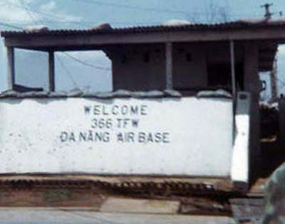 13. Da Nang AB, Front Gate 1968. Shrapnel holes all around the sign, Welcome 366 TFW Da Nang Air Base. Photo by: Greg Dunlap, DN, 366th SPS K9, 1968-1969.