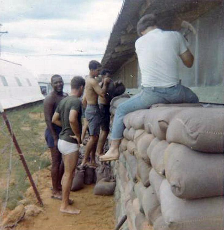 8. Da Nang AB, 366th SPS.Adding layers to sandbag wall around huts. Photo by: Ralph Manganiello Jr. 1966-1967.