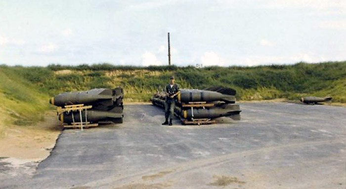 12. Da Nang AB, 366th SPS.Bomb Dump, racks of 750 LB M117A3 Explosive US Bomb. Photo by: Ralph Manganiello Jr. 1966-1967.