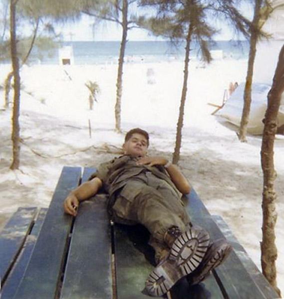 14. Da Nang AB, 366th SPS.A day at China Beach. Picnic table under palm tress... and a snooze. Photo by: Ralph Manganiello Jr. 1966-1967.