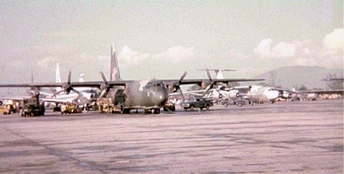 23. East flight line. C-130 and various aircraft parking.