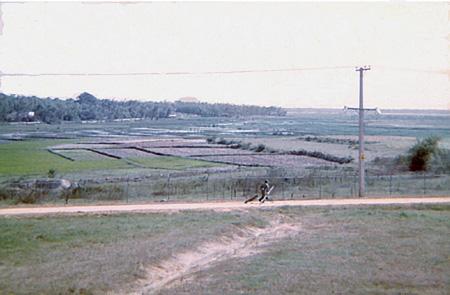 32. Da Nang AB, East perimeter Road. K-9 and handler.