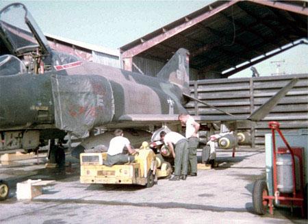 27.Fightline. Revetment. F-4 Phantom, bomb loading.
