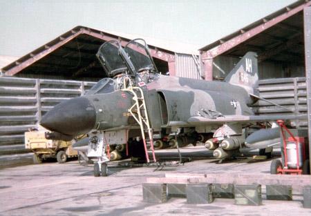26.Fightline. Revetment. F-4 Phantom, bomb loading.