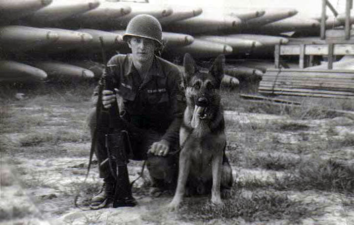 3. Da Nang AB, 366th SPS, K-9: I moved to Colorado, so thought I would pass on this picture of me and shep near the Da Nang Kennels, 1965 . Photo by: Lee Miller, Nov 1966.