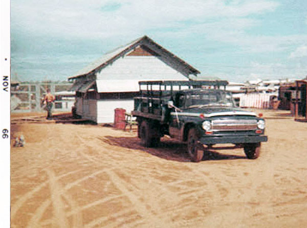 5. Da Nang AB, 366th SPS, K-9: Growl Pad Squadron Room building. K-9 Posting Truck parked nearby. Photo by: Lee Miller, Nov 1966.